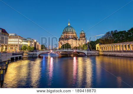 The Berlin Cathedral at the river Spree at night