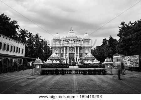 Sri Ramakrishna Math historical building in Chennai, Tamil Nadu, India in the evening with cloudy sky. Black and white