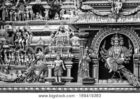 Chennai, India. Close view of religious figures of famous Arulmigu Kapaleeswarar Temple in Chennai the capital of Tamil Nadu, India. Black and white