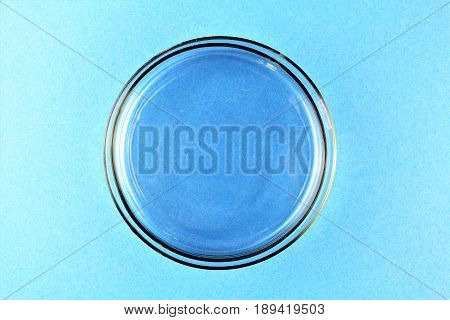 A Petri dish (aka Petrie dish, Petri plate or cell culture dish) cylindrical glass or plastic lidded dish used to culture cells such as bacteria or mosses