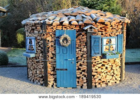 An Image of a Wood house - fire wood