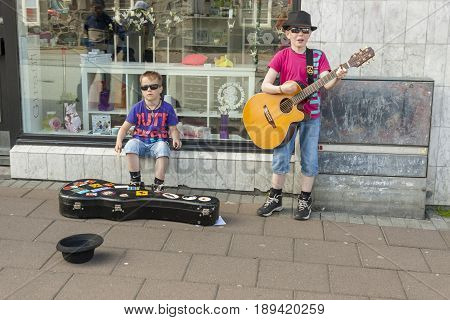 REYKJAVIK ICELAND - AUGUST 4: Two boys singing a song on street on august 4 2010 in Reykjavik.