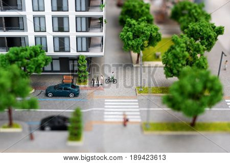 Miniature model, miniature toy buildings, cars and people. City maquette