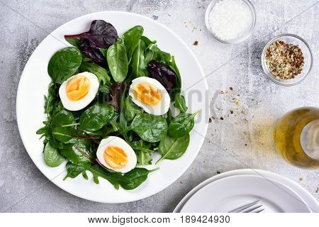 Green salad with fresh leaves and eggs healthy food top view