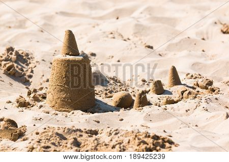 Sandcastle on the sand of a beach in Italy