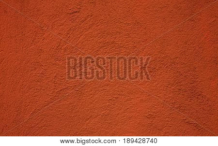 Orange Abstract Decorative background. Grunge Painted Stucco Wall Texture. Beautiful Handmade Rough Wallpaper With Copy Space