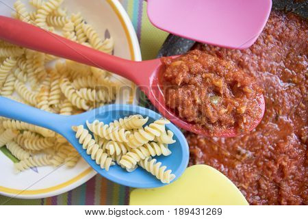 raw pasta with bolognese sauce or ragù bolognese style
