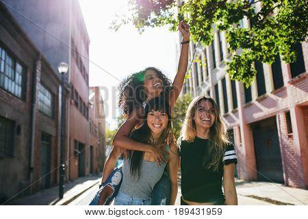 Happy Young Women Enjoying On City Street