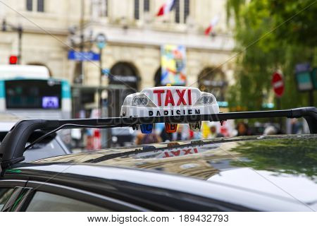 Closeup of taxicab sign in Paris France
