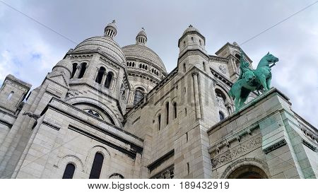View of Basilica Sacre Coeur Roman Catholic Church and minor basilica dedicated to Sacred Heart of Jesus Paris France