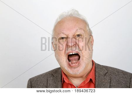 Elderly person crying aggressive - on bright background