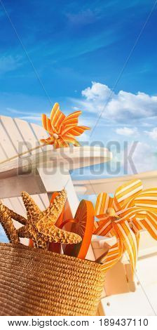 Beach items on chair with blue sky in background
