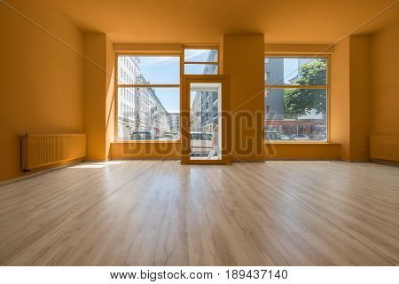 Renovated Store / Shop - Empty Room With Wooden Floor And Shopping Window
