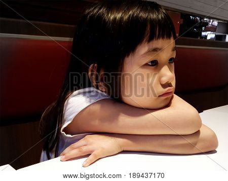 Lonely Girl Sitting By Herself In a Fast Food Restaurant