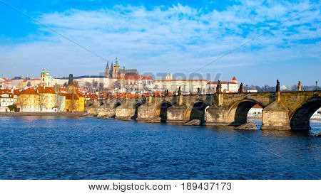Prague Hradcany Panorama on sunny day. Charles Bridge over Vltava River with Prague Castle, Czech Republic.