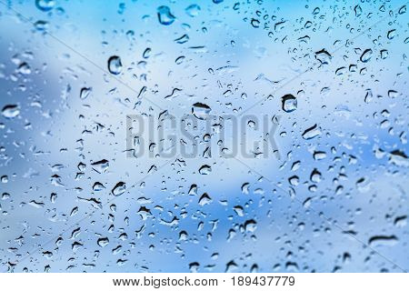 Closeup shot of water drops on the glass
