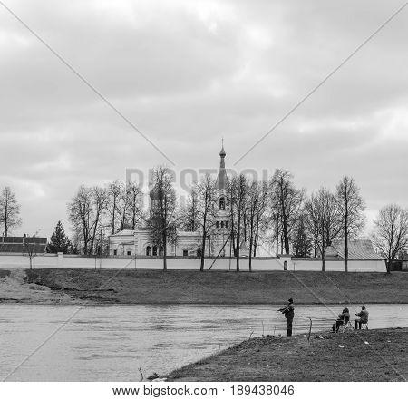 Belarus Orsha - April 11 2017: Three fishermen on the river bank. Black and white processing