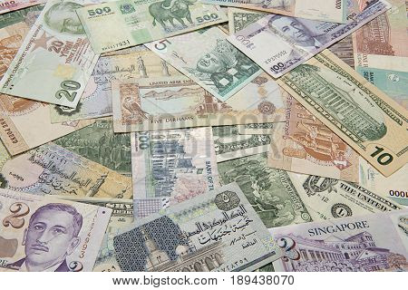 Variety of international paper currency background.