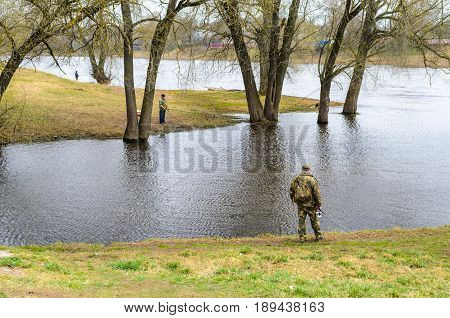 Belarus Orsha - April 11 2017: Three fishermen on the river bank