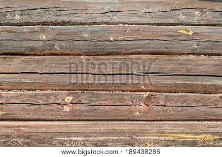 Log masonry texture. Wooden house background. Old texture on old logs.