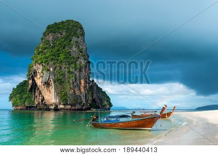 Small Traditional Thai Boats Off The Coast Of Phra Nang, Thailand