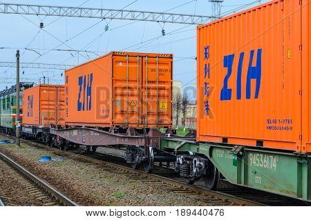 Belarus Orsha - April 11 2017: Transportation of cargoes by rail in containers. Railway infrastructure background