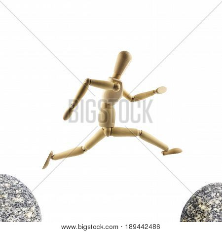 Wooden mannequin is jumping over the abyss isolated on white background. Big jump concept.
