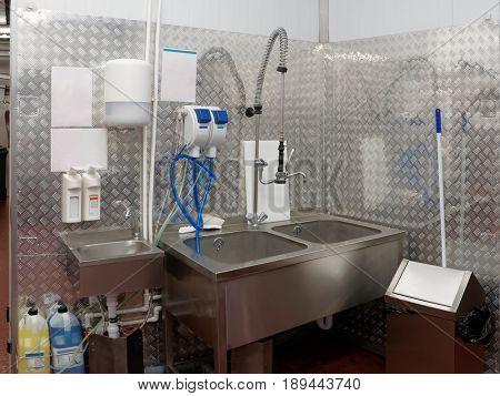 Modern dish-washing room at food processing plant