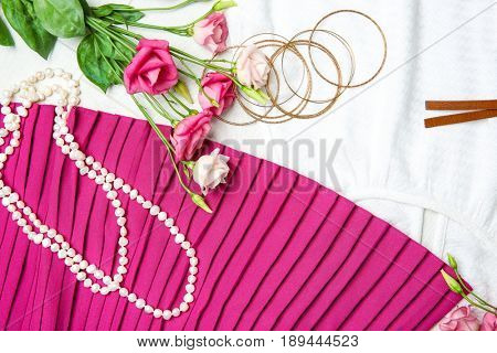 Clothes with accessories and flowers, flat lay