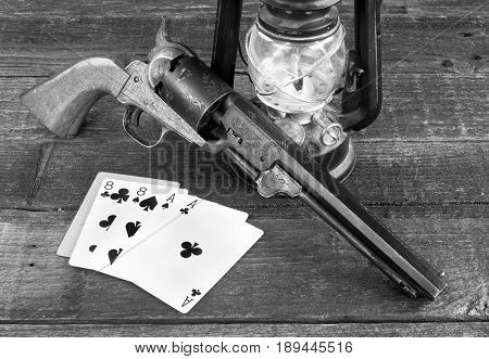 Dead man's hand ace's and eights in the old wild west in black and white.