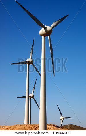 Eolic power generator: windmills over blue sky