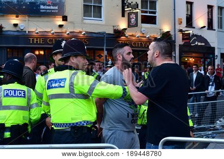 CARDIFF UK - 3 JUNE 2017 Man arrested by police during Champions League Final. British police and security services on high alert as hundreds of thousands of fans enjoy football in the capital of Wales