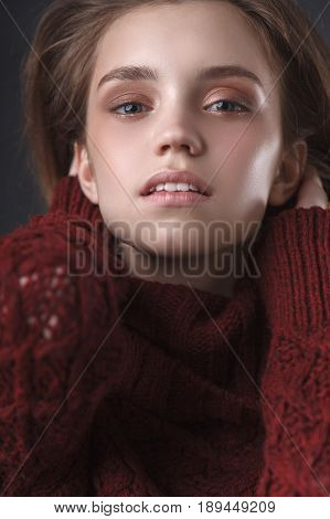 young teenage blonde girl closeup portrait over dark background