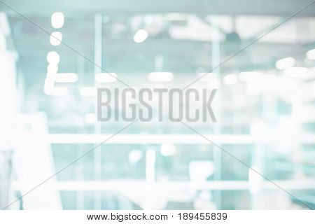 Abstract blur modern business office white and blue bokeh lights background with motion blur for your design
