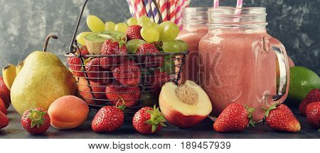 Dietary fruit smoothies on a gray background