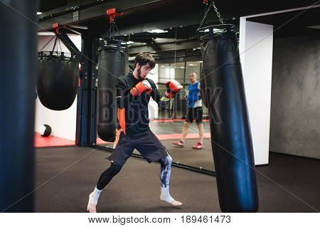 Professional Muay Thai Fighter. Male Boxer In Training Sportswear, An Exercise In Sports Hall, Train