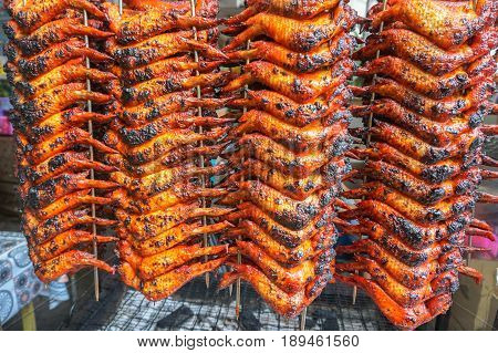Malaysian barbecue chicken wings in food market at Kota Kinabalu,Sabah,Malaysia.Grilled or barbequed chicken wings are very popular in Malaysia.In almost any hawker center or food court.
