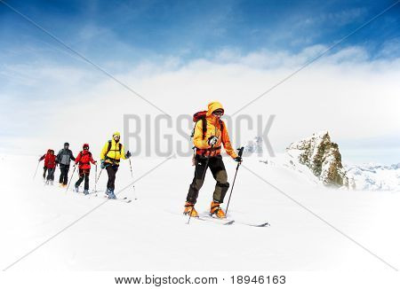 Group of alpine touring skiers on the big Verra Glacier; in background the Matterhorn, Swiss-Italy border.