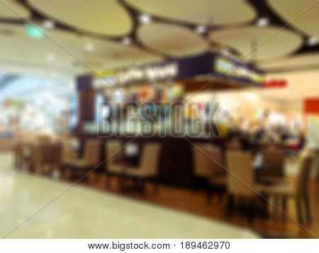 Abstract blur and defocused restaurant in shopping mall department and retail store interior for background.
