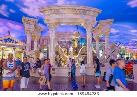 LAS VEGAS, NV - NOVEMBER 21, 2016: An unidentified people walking in the interior of Venetian Hotel in Las Vegas watching a beautiful statue.