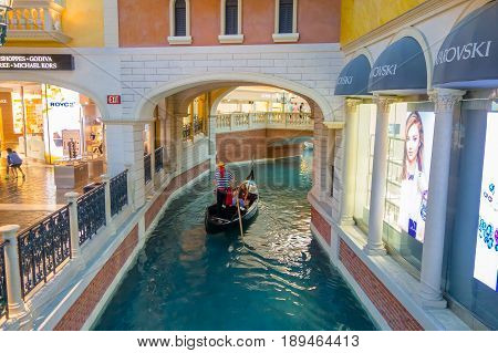 LAS VEGAS, NV - NOVEMBER 21, 2016: An unidentified people in the gondola of the Venetian hotel replica of a Grand canal in Las Vegas with more than 4000 suites it s one of the most famous hotels in the world.