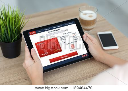 woman hands holding tablet shoping fingerprint and credit card in online store