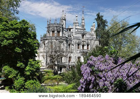 SINTRA - APRIL 07: Quinta da Regaleira palace is an estate located in the municipality of Sintra about 25km northwest of Lisbon. April 07 2017 in Sintra Portugal