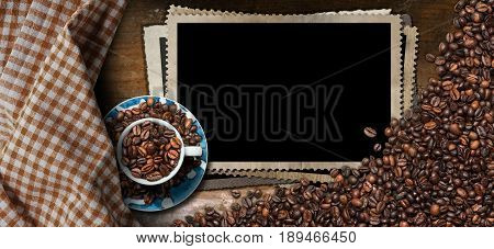 Empty photo frames for a coffee house with a cup and roasted coffee beans on a wooden table with checkered tablecloth
