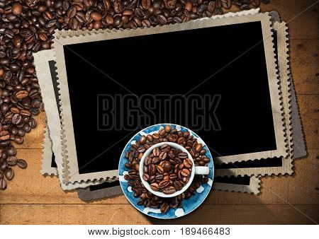 Empty photo frames for a coffee house with a cup and roasted coffee beans on a wooden table