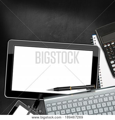 Office desk with a blank digital tablet computer keyboard pencil calculator drawing compass and smartphone. On a Blackboard with copy space