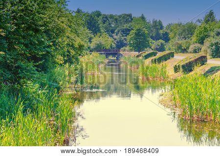 Old concrete bridges over a moat in a park