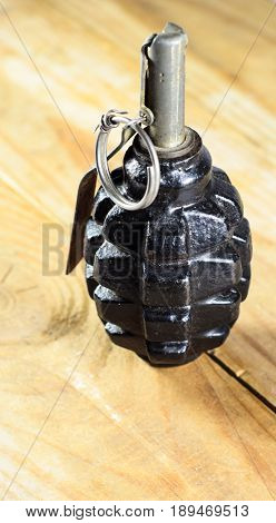 Black Hand Grenade On A Wooden Table