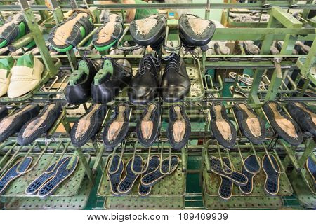 The conveyor of the shoe factory, mass production of footwear.