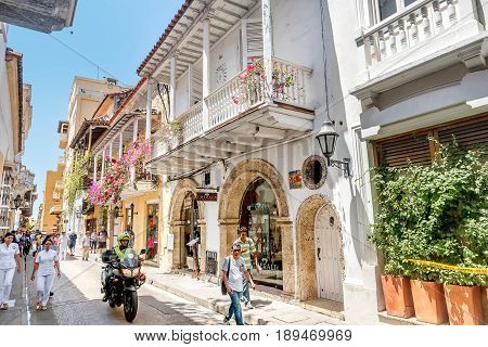 Cartagena, Colombia- March 2, 2017: Police officer on the motorcycle patrols the streets in old town Cartagena Colombia